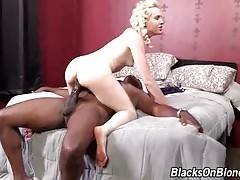 Attractive blonde greatly enjoys passionate black cock riding.