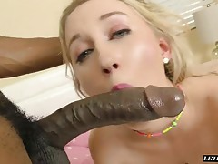 Pretty blonde babe with a nice sexy ass hangs out by the pool and gets really hot under the sun. She feels her pussy getting wet, so she takes off her booty shorts and rubs the ass and pussy haard. Her man appears with her favorite stick. The long black p